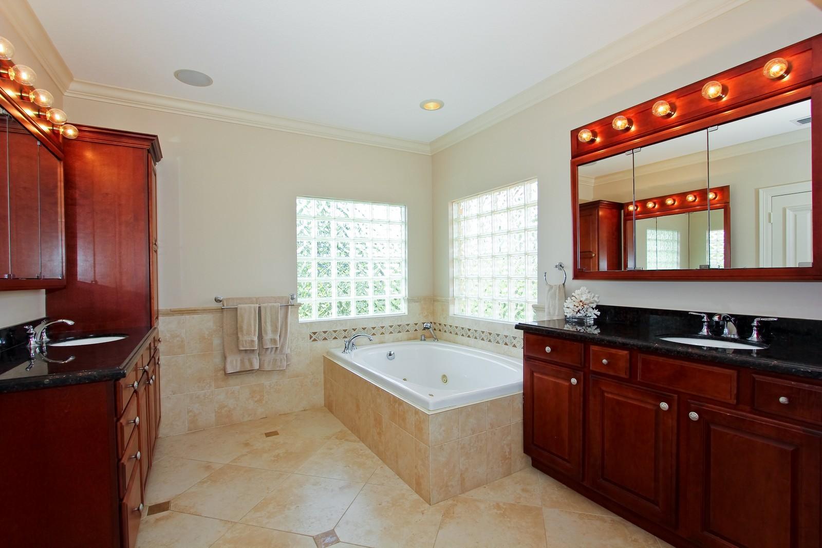 Real Estate Photography - 430 N. Lyra Circle, Juno Beach, FL, 33408 - Master Bathroom