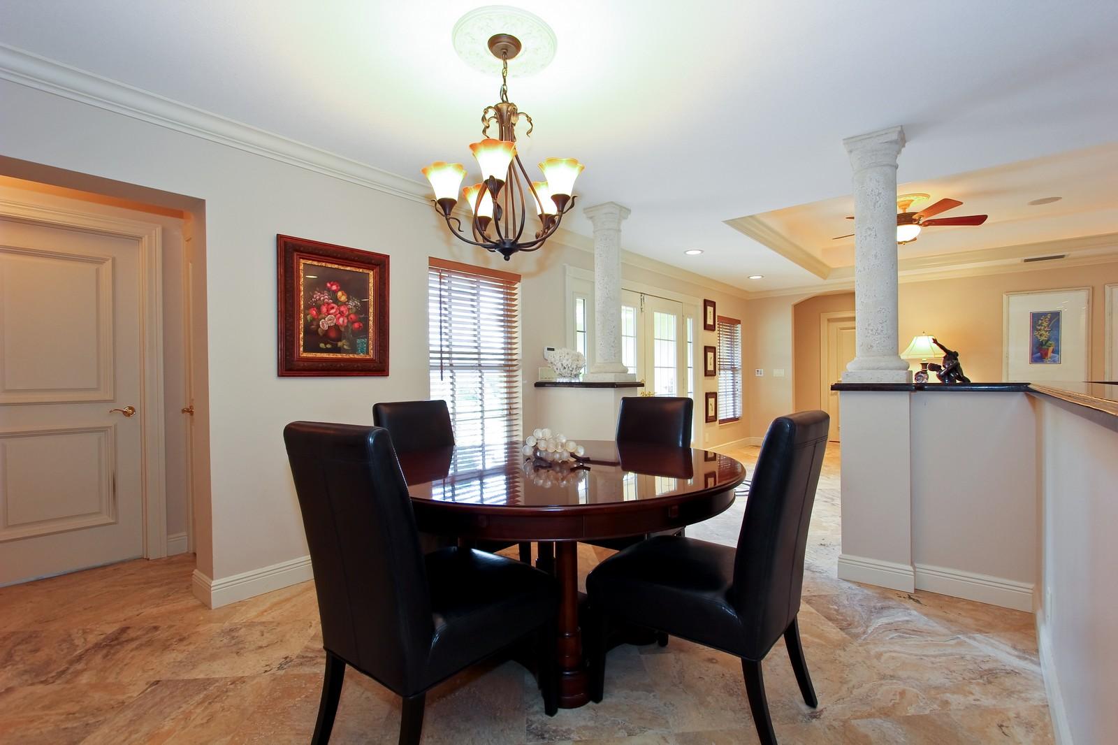 Real Estate Photography - 430 N. Lyra Circle, Juno Beach, FL, 33408 - Dining Room