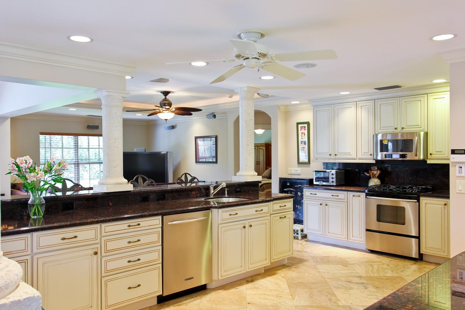 Real Estate Photography - 430 N. Lyra Circle, Juno Beach, FL, 33408 - Kitchen