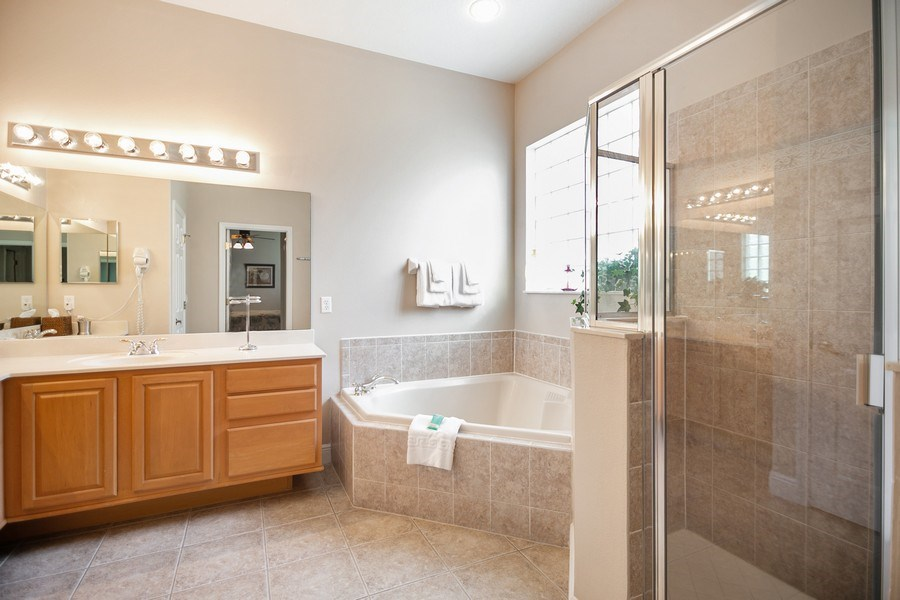 Real Estate Photography - 7528 Gathering Drive, reunion, FL, 34747 - Master Bathroom