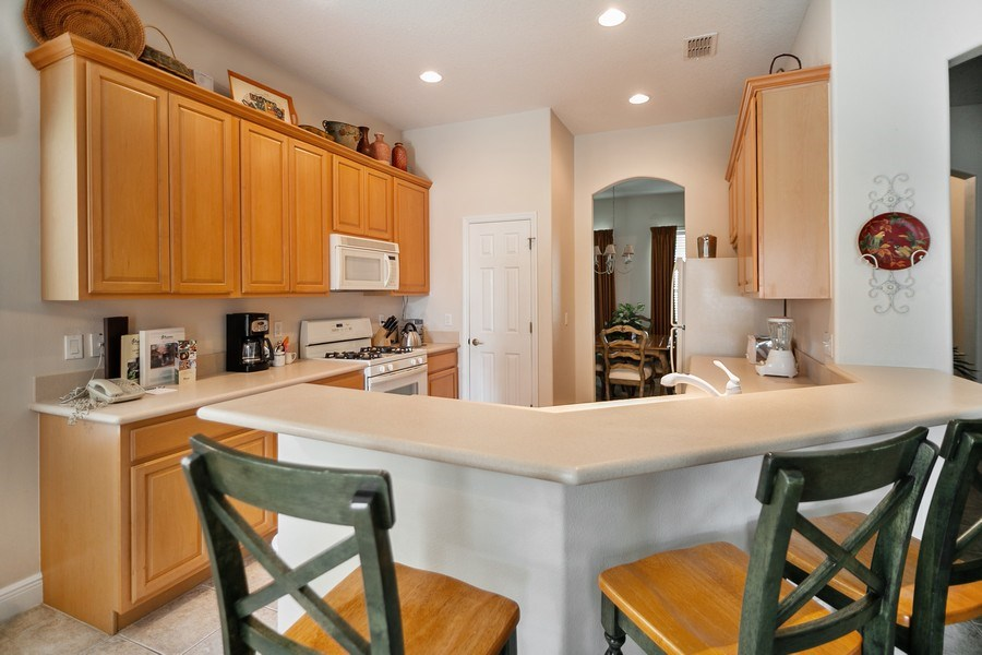 Real Estate Photography - 7528 Gathering Drive, reunion, FL, 34747 - Kitchen / Breakfast Room