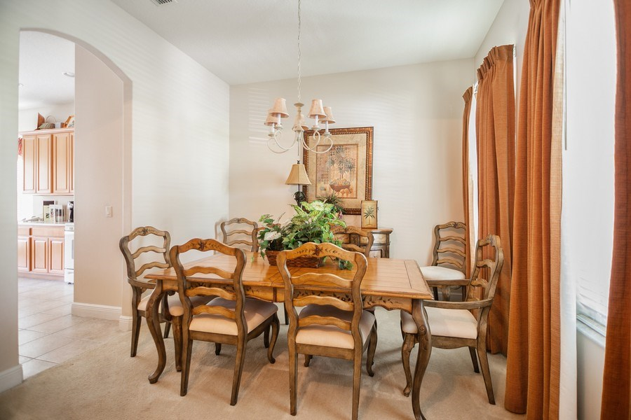Real Estate Photography - 7528 Gathering Drive, reunion, FL, 34747 - Dining Area