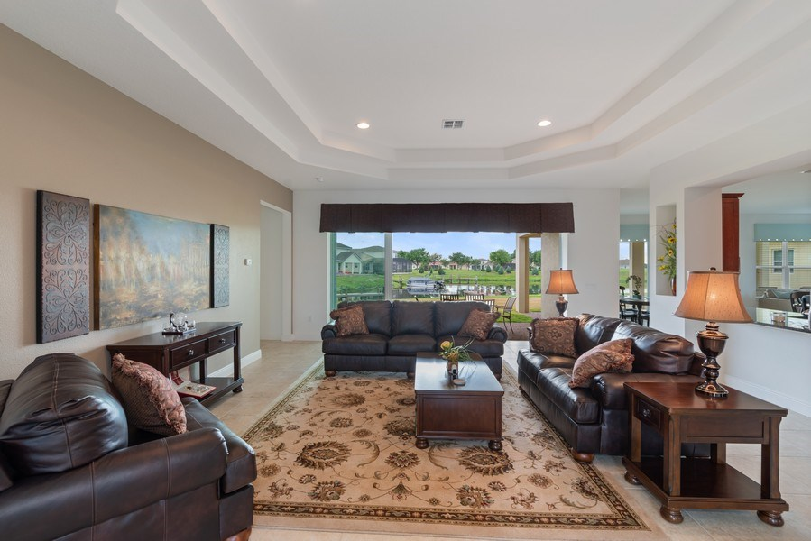 Real Estate Photography - 1141 Terralago Way, Kissimmee, FL, 34746 - Family Room
