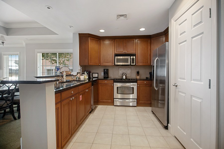 Real Estate Photography - 1364 Centre Court Ridge unit 104, Kissimmee, FL, 34747 - Kitchen