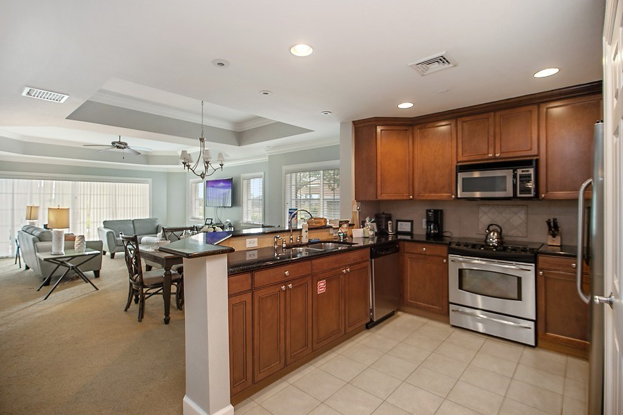 Real Estate Photography - 1364 Centre Court Ridge unit 104, Kissimmee, FL, 34747 - Kitchen / Living Room