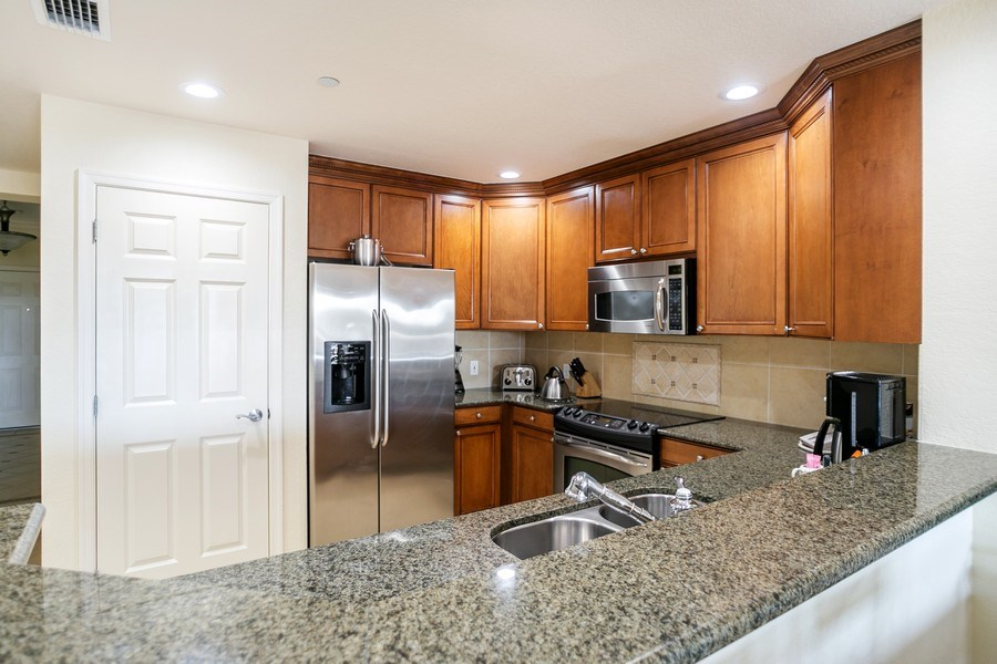 Real Estate Photography - 7601 Cabana Ct Unit 401, Reunion, FL, 34747 - Kitchen