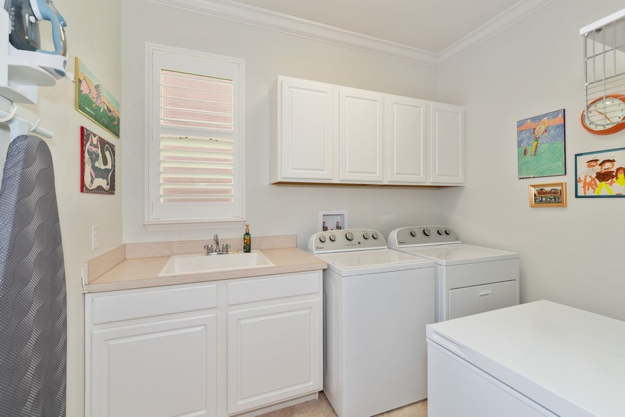 Real Estate Photography - 9046 Reflection Pointe Dr, Windermere, FL, 34786 - Laundry Room