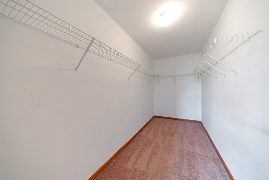 Real Estate Photography - 131 Springbrook Trail South, Oswego, IL, 60543 - Master Bedroom Closet