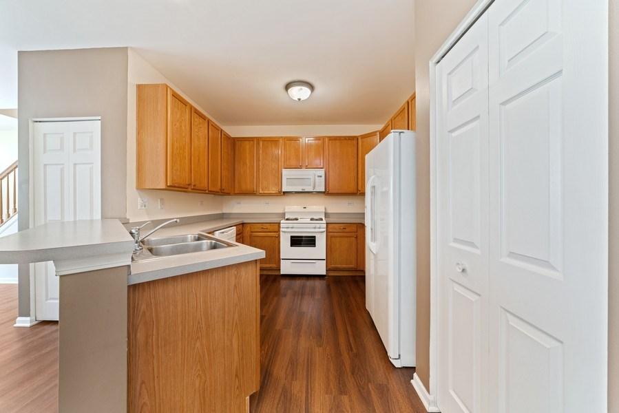 Real Estate Photography - 131 Springbrook Trail South, Oswego, IL, 60543 - Kitchen