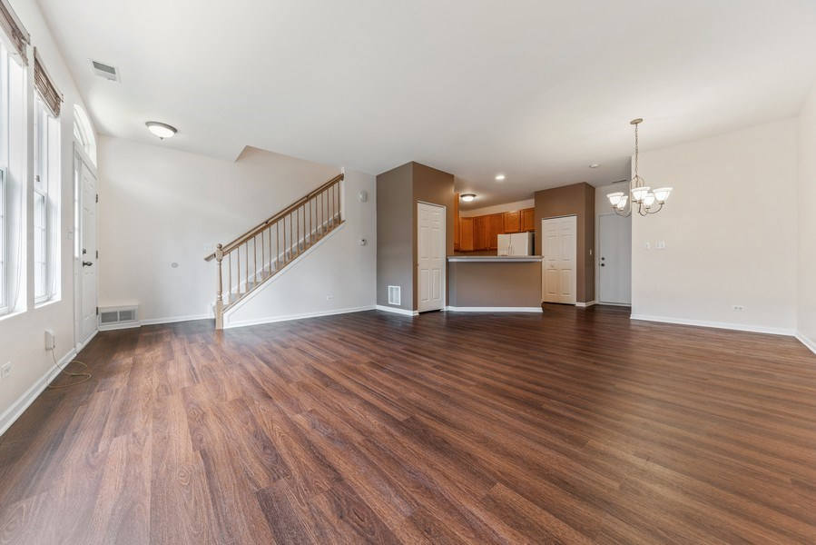 Real Estate Photography - 131 Springbrook Trail South, Oswego, IL, 60543 - Living Room/Dining Room