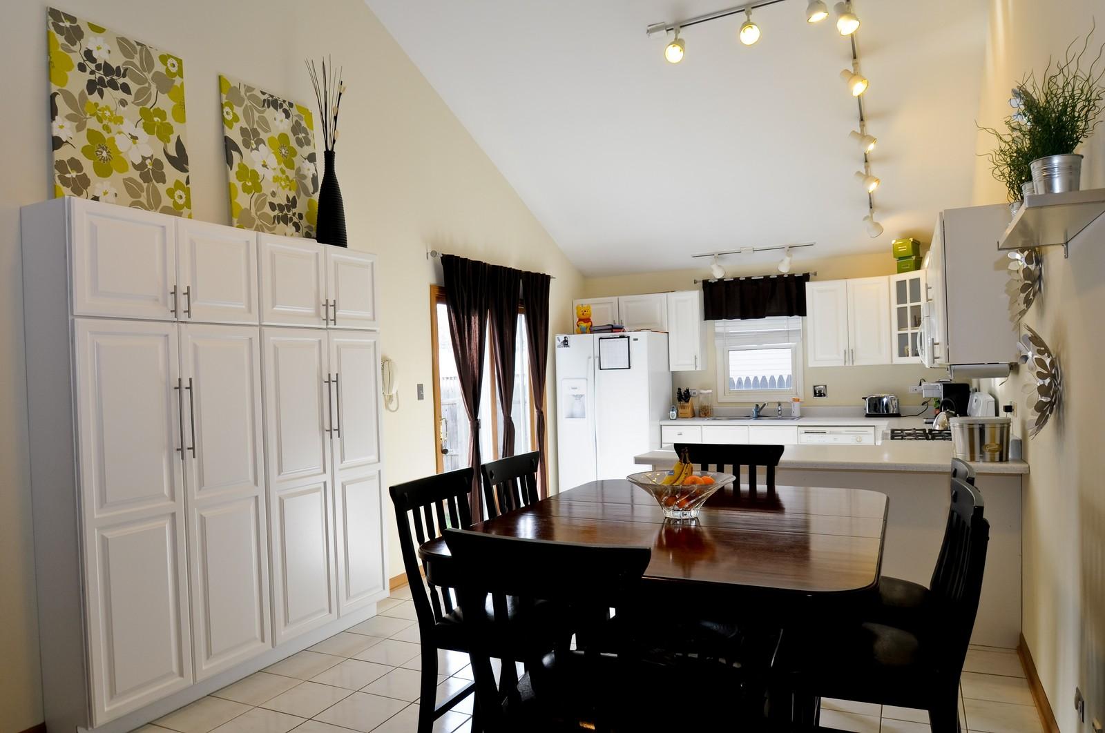 Real Estate Photography - 28 W. 31st Street, Steger, IL, 60475 - Kitchen / Breakfast Room