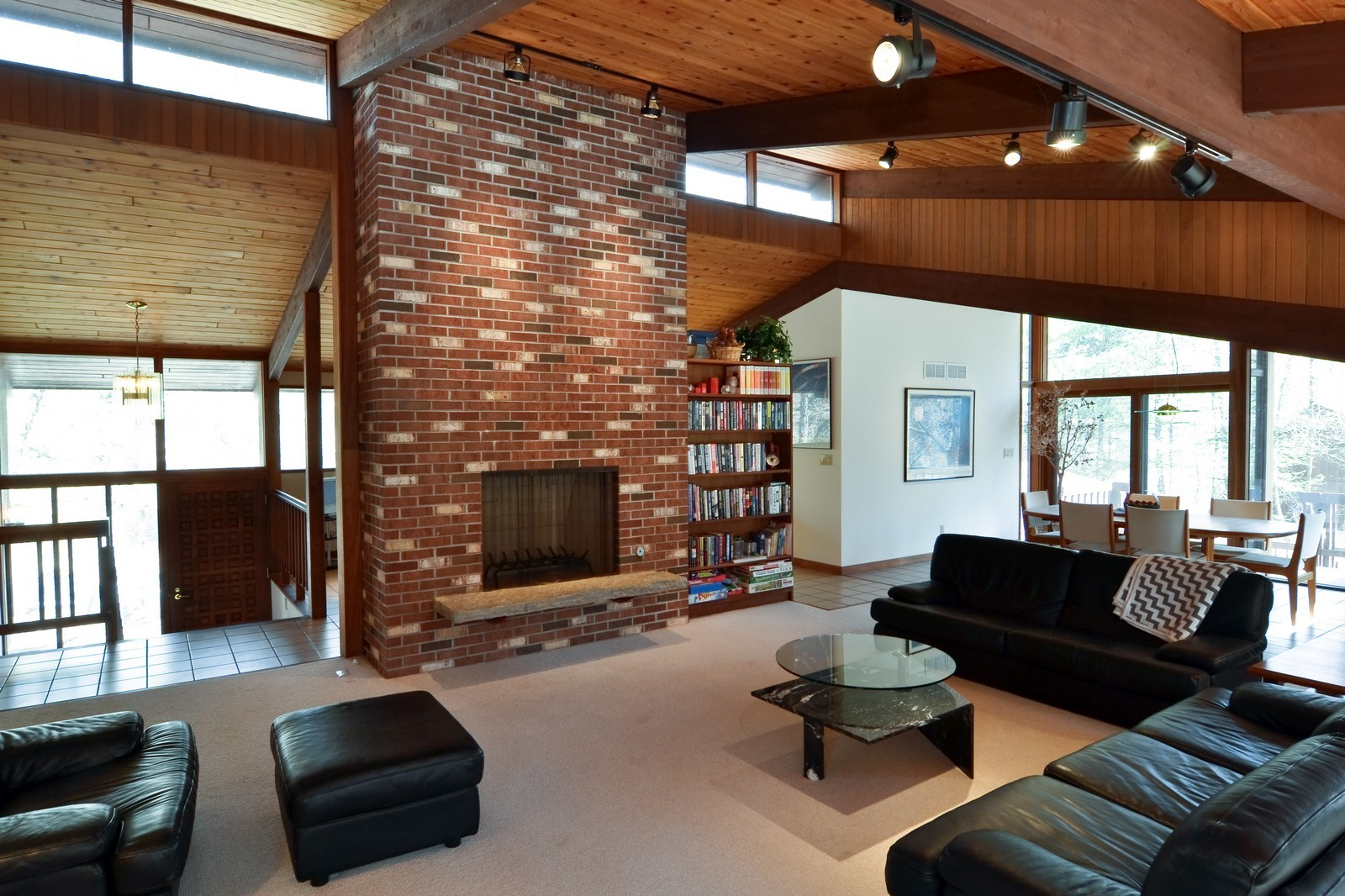 Real Estate Photography - 6 Pine Ln, Dune Acres, IN, 46304 - Open Living / Dining Rm Anchored By Brick Fireplac
