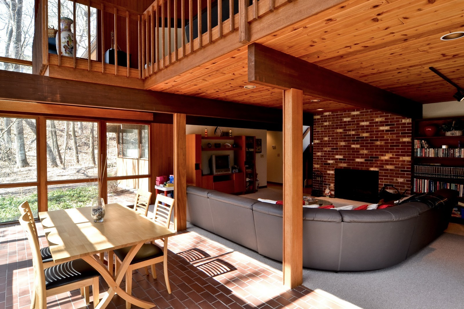 Real Estate Photography - 6 Pine Ln, Dune Acres, IN, 46304 - Lower Level Family Room With Fireplace & Sunroom
