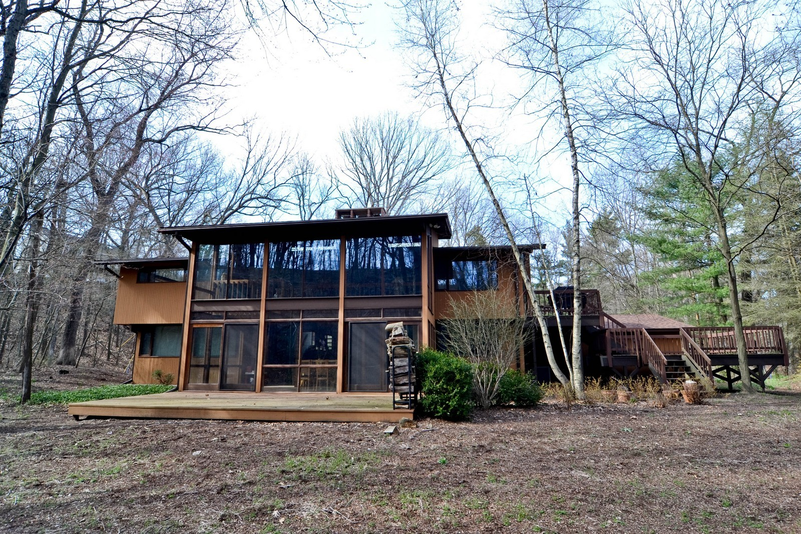Real Estate Photography - 6 Pine Ln, Dune Acres, IN, 46304 - Multiple Decks & Large Backyard Surrounded By Dune