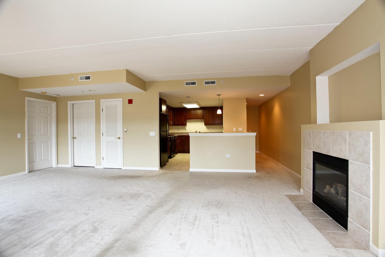 Real Estate Photography - 570 Crescent Blvd., 301, Glen Ellyn, IL, 60137 - Living Room / Dining Room
