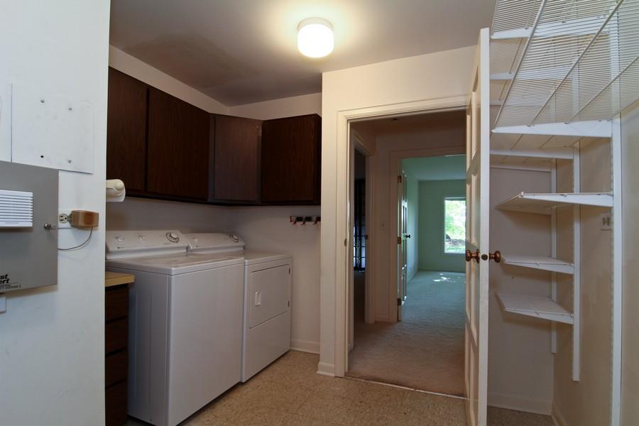 Real Estate Photography - 3 Oak Brook Club, D103, Oak Brook, IL, 60523 - Laundry Room