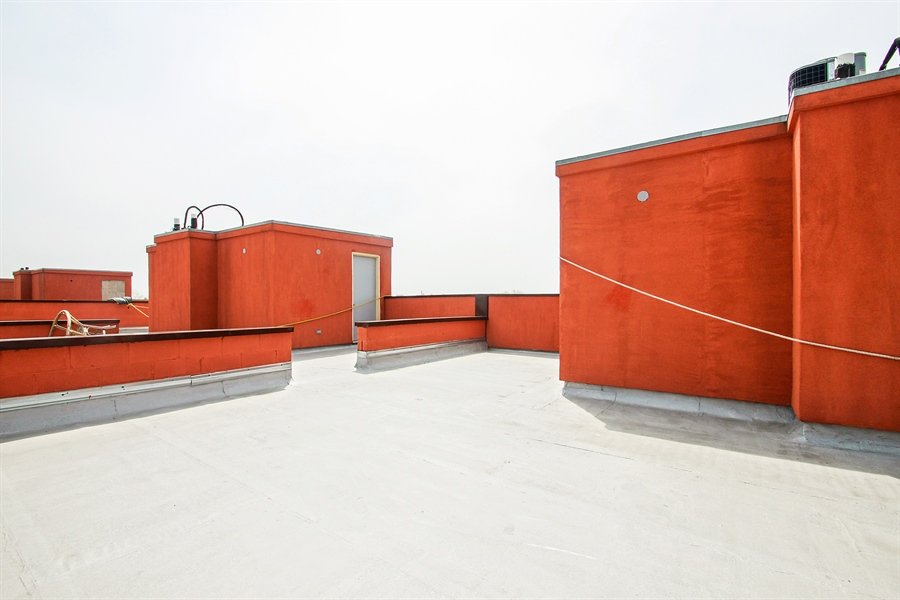 Real Estate Photography - 7227 S Exchange, Unit a, Chicago, IL, 60649 - Roof