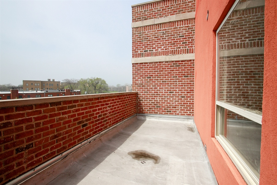 Real Estate Photography - 7227 S Exchange, Unit a, Chicago, IL, 60649 - Balcony