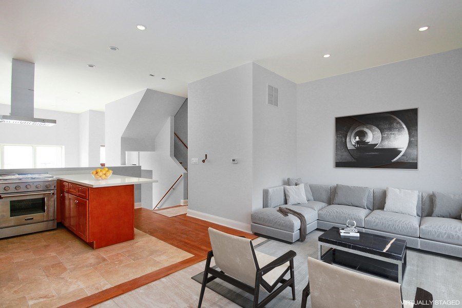 Real Estate Photography - 7227 S Exchange, Unit a, Chicago, IL, 60649 - Kitchen / Living Room