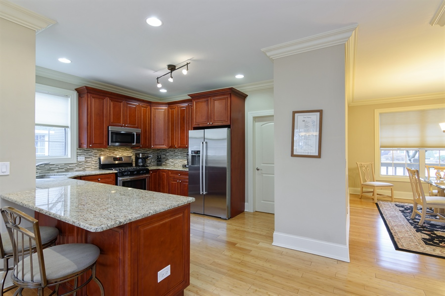 Real Estate Photography - 720 Foxmoore, Lake Zurich, IL, 60047 - Kitchen / Dining Room