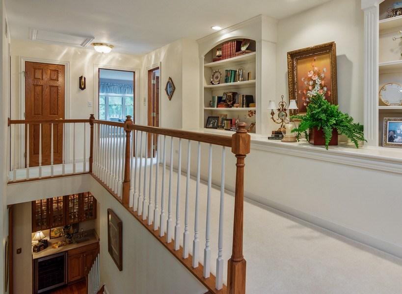Real Estate Photography - 1 Burning Oak Trail, Barrington Hills, IL, 60010 - Beautful Built in shelving in hallway