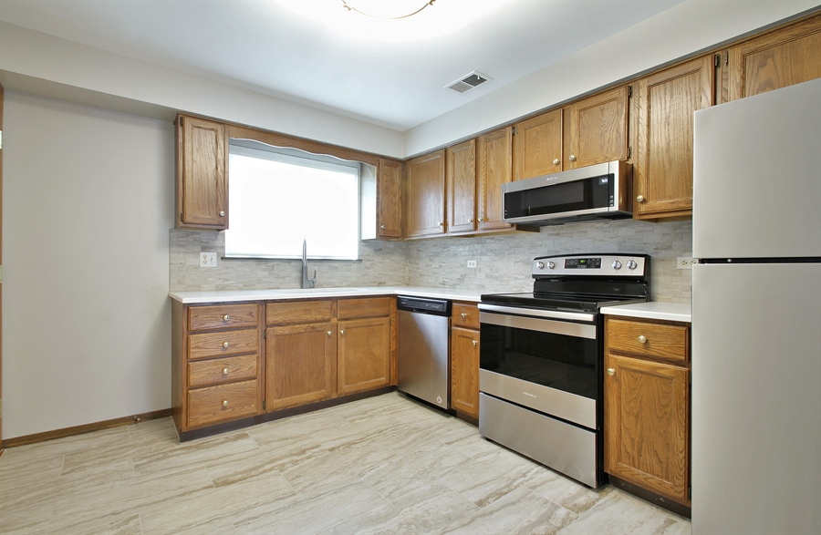 Real Estate Photography - 8421 W. Gregory, 201, Chicago, IL, 60656 - Kitchen