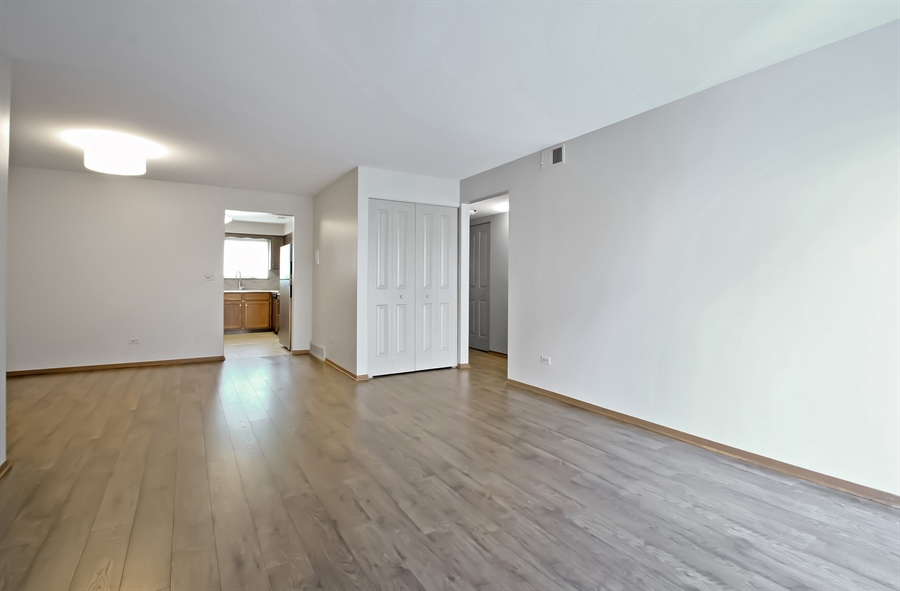 Real Estate Photography - 8421 W. Gregory, 201, Chicago, IL, 60656 - Living Room / Dining Room