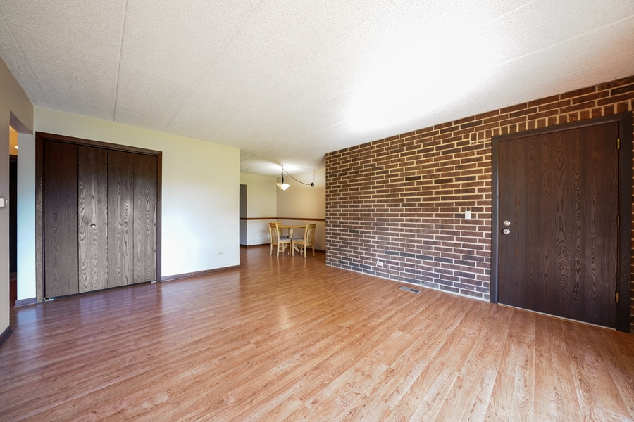 Real Estate Photography - 135 E Grand Ave, GF, Bensenville, IL, 60106 - Living Room / Dining Room