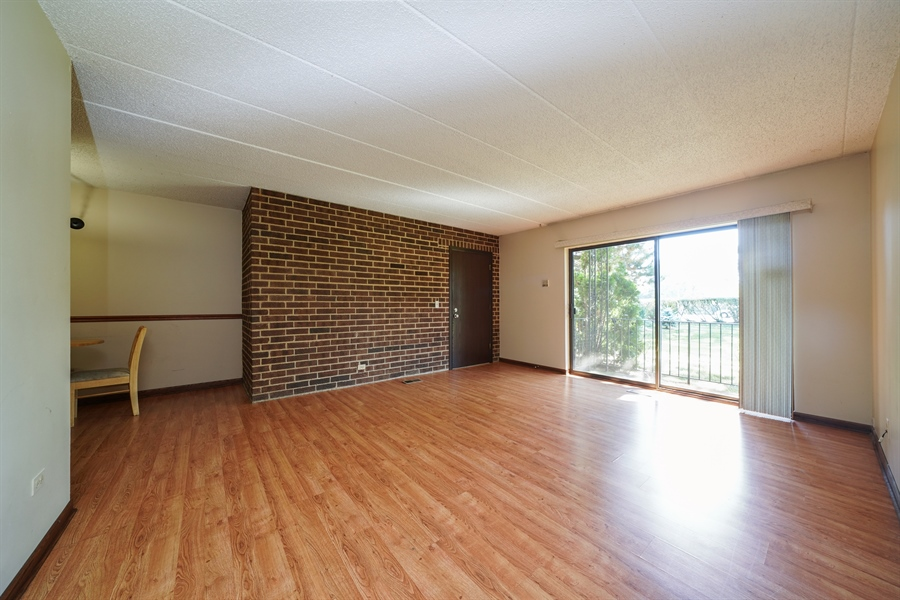 Real Estate Photography - 135 E Grand Ave, GF, Bensenville, IL, 60106 - Living Room/Dining Room