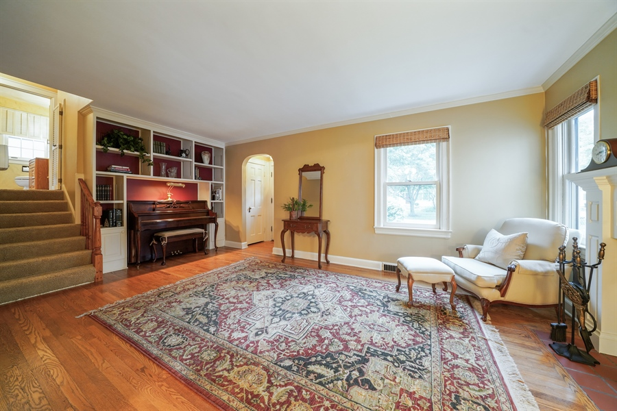 Real Estate Photography - 3932 Grove Ave, Western Springs, IL, 60558 - Living Room with Built-in Bookcases