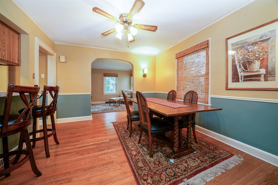 Real Estate Photography - 3932 Grove Ave, Western Springs, IL, 60558 - Dining Room opens to Living Room, Kitchen, and Fam