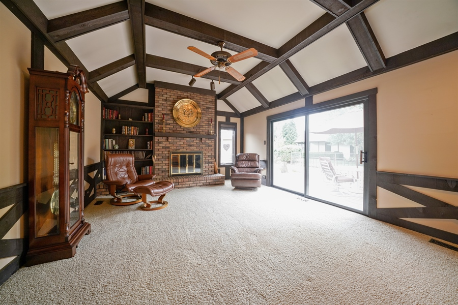 Real Estate Photography - 3932 Grove Ave, Western Springs, IL, 60558 - Spacious Family Room with Fireplace and sliding do