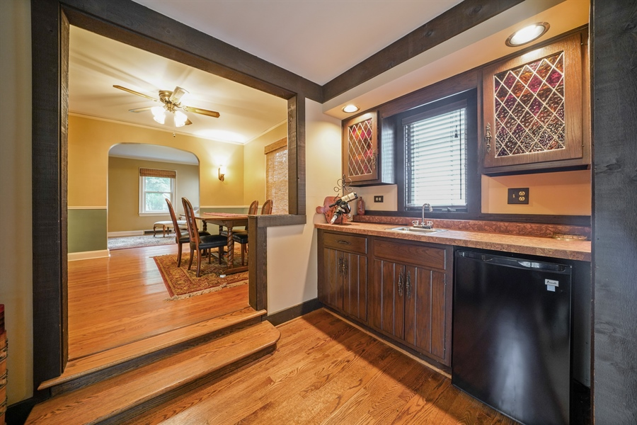 Real Estate Photography - 3932 Grove Ave, Western Springs, IL, 60558 - Dining Room leads to Butler's Pantry and Family Ro
