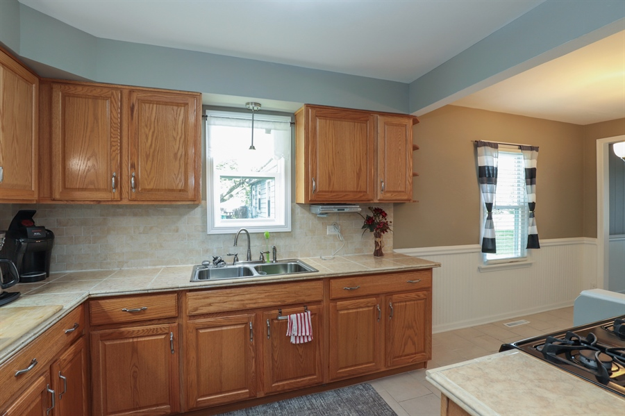 Real Estate Photography - 1428 Pine Grove Ave, Round Lake Beach, IL, 60073 - Kitchen