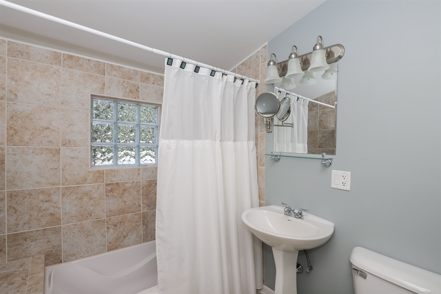 Real Estate Photography - 1428 Pine Grove Ave, Round Lake Beach, IL, 60073 - 2nd Bathroom