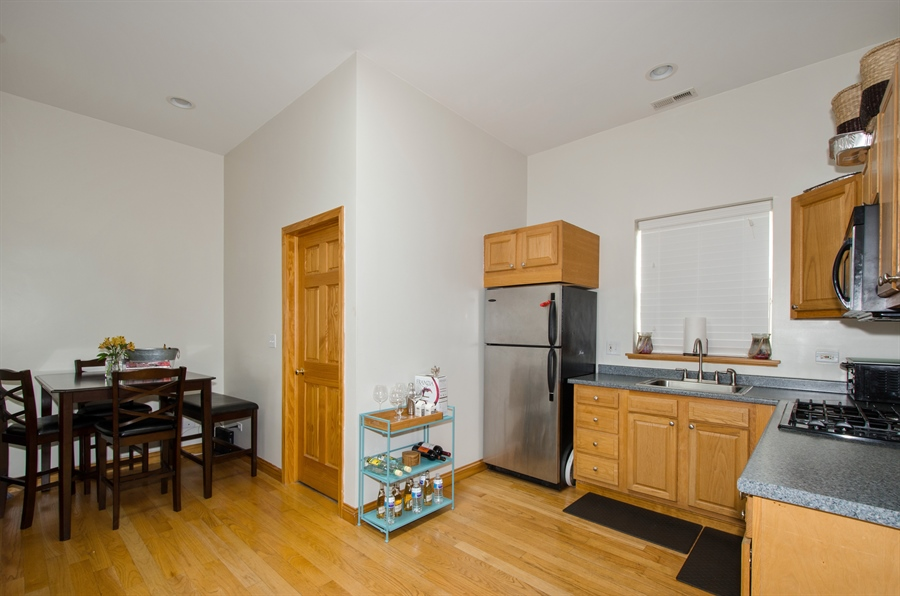 Real Estate Photography - 5481 N Milwaukee, Chicago, IL, 60630 - Kitchen / Dining Room