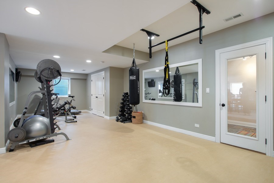 Real Estate Photography - 937 Kenyon St, Downers Grove, IL, 60516 - Lower Level Gym/Bedroom 5/Play Room