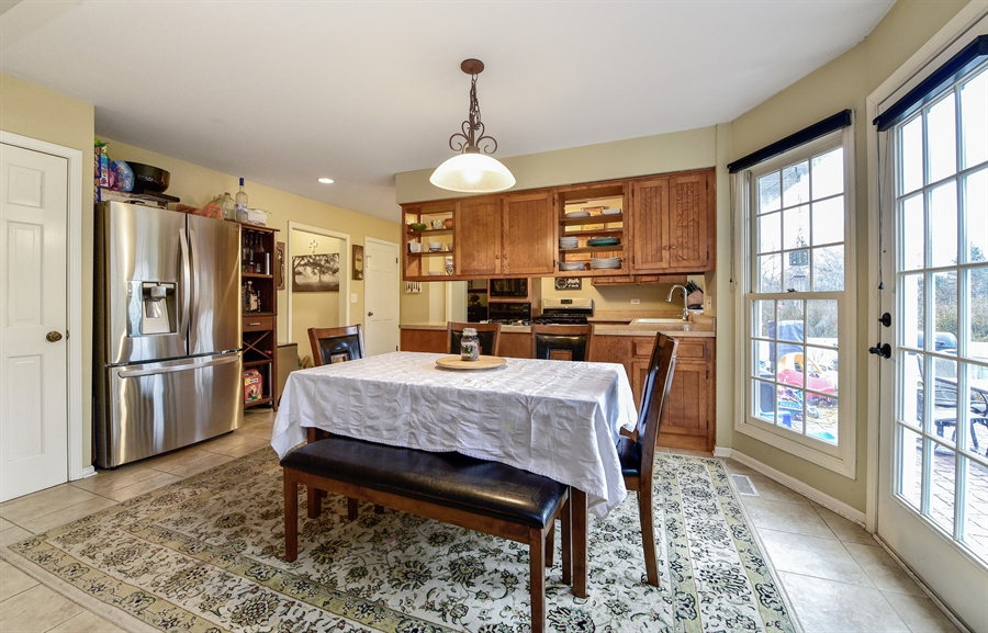 Real Estate Photography - 313 Queens Pkwy, Bartlett, IL, 60103 - Kitchen / Breakfast Room