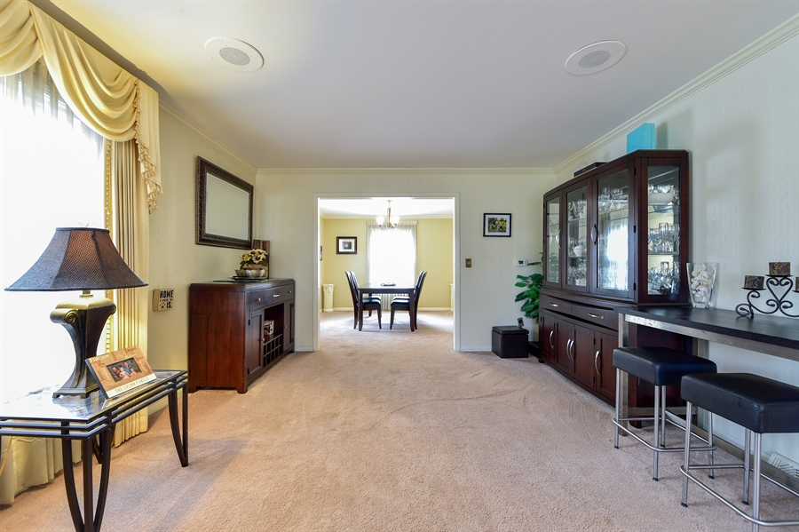 Real Estate Photography - 313 Queens Pkwy, Bartlett, IL, 60103 - Living Room / Dining Room