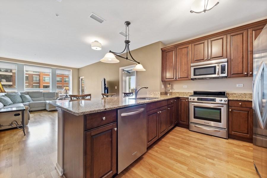 Real Estate Photography - 801 Village Center Dr #201, Burr Ridge, IL, 60527 - Kitchen