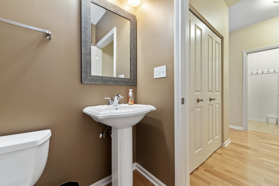 Real Estate Photography - 801 Village Center Dr #201, Burr Ridge, IL, 60527 - Powder Room