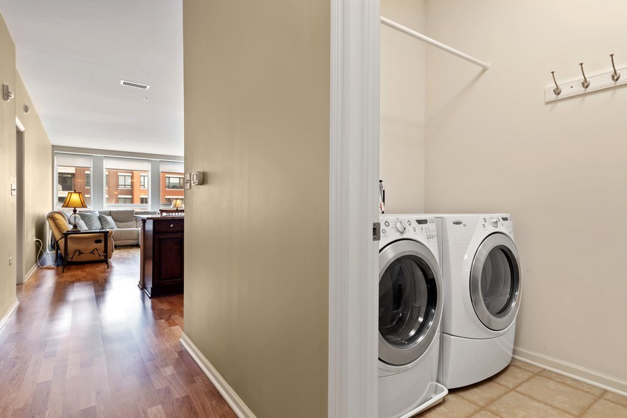 Real Estate Photography - 801 Village Center Dr #201, Burr Ridge, IL, 60527 - Laundry Room