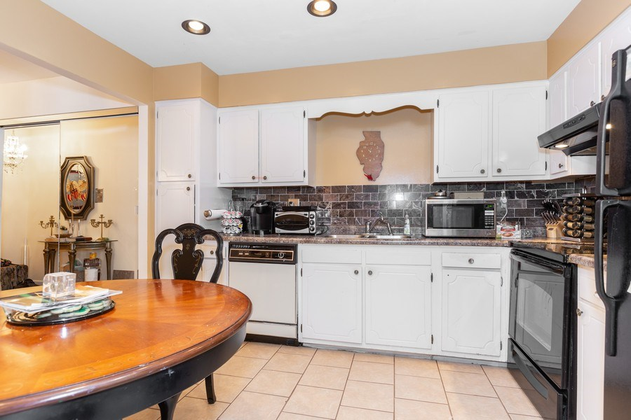 Real Estate Photography - 4250 Saratoga Ave., Unit 114, Downers Grove, IL, 60515 - Kitchen (alternate view)