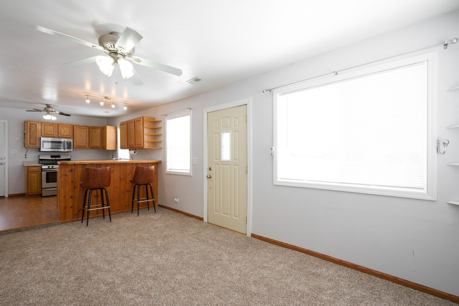 Real Estate Photography - 718 Sheridan Rd, Wauconda, IL, 60084 - Kitchen / Living Room