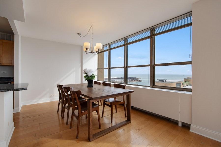 Real Estate Photography - 655 W Irving Park Rd, Unit 2601, Chicago, IL, 60613 - Dining Room