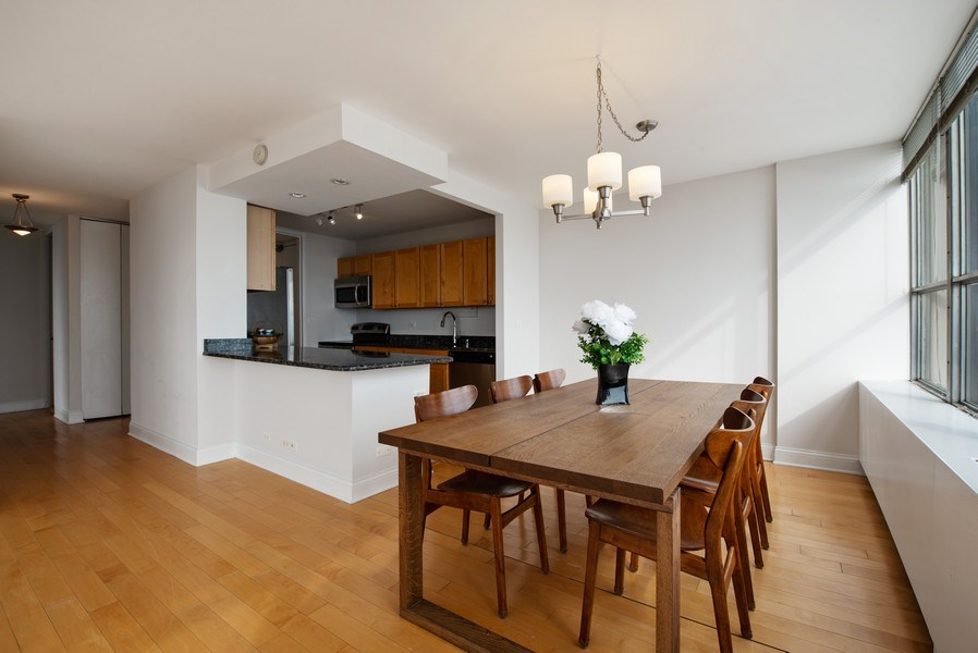 Real Estate Photography - 655 W Irving Park Rd, Unit 2601, Chicago, IL, 60613 - Kitchen / Dining Room