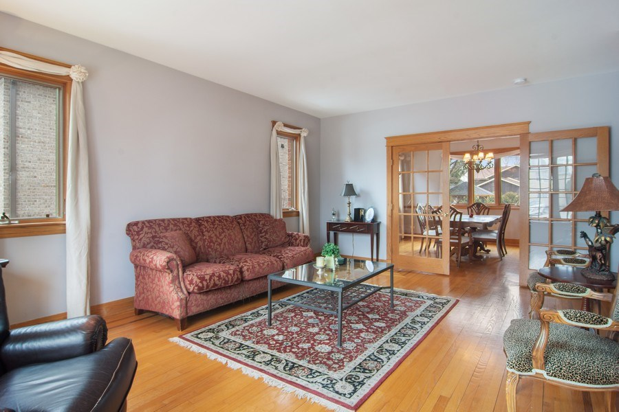 Real Estate Photography - 1001 Wildwood, Mt Prospect, IL, 60056 - Living Room to French Doors and Dining Rm