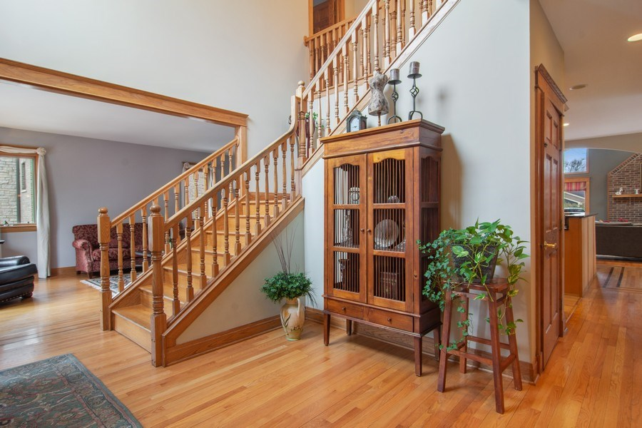 Real Estate Photography - 1001 Wildwood, Mt Prospect, IL, 60056 - 2 Story Foyer - Grand Oak Stairway