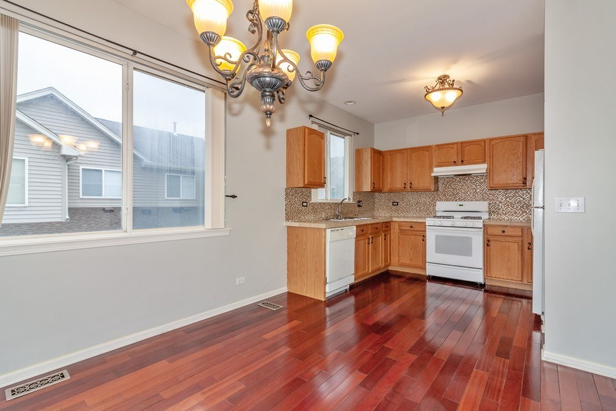 Real Estate Photography - 11s520 Rachael Court, Willowbrook, IL, 60527 - Kitchen / Dining Room