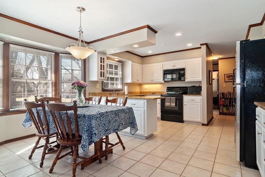 Real Estate Photography - 1302 Brush Hill Circle, Naperville, IL, 60543 - Updated kitchen cabinets w/ Cambria Quartz Counter